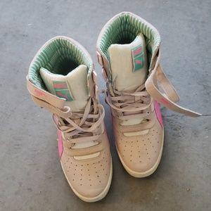 Puma high top heeled sneakers